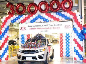 Kia celebrates its 300,000th vehicle, a silver Sorento.