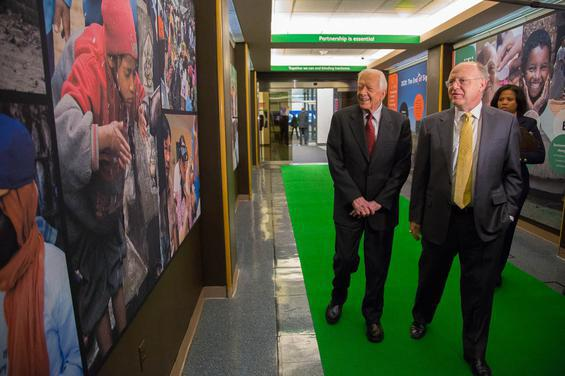 Former President Carter, founder of the Carter Center, and Ian Read, CEO of Pfizer, tour the Internatoinal Trachoma Initiative exhibit at Pfizer headquarters in New York.