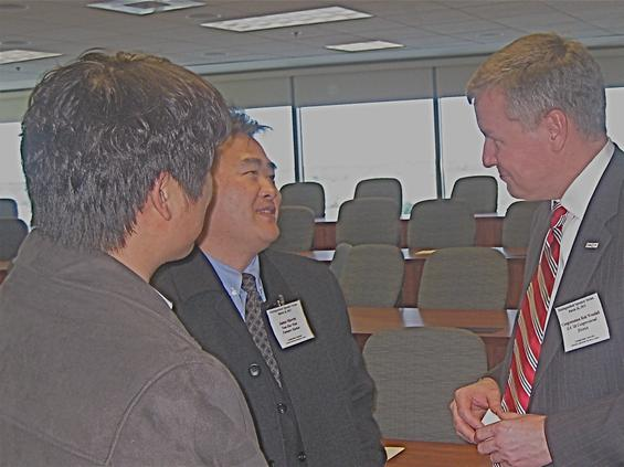 U.S. Rep. Robert Woodall chats with attendees at GSU's Korean-American Business Center forum.