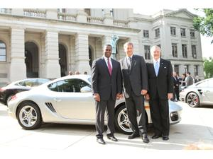 Left to right: Atlanta Mayor Kasim Reed, Detlev Von Platen, president and CEO of Porsche Cars America, and Gov. Nathan Deal visit a selection of Porsches on the lawn of Georgia's state Capitol following their May 12th joint announcement.
