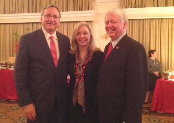 OutgoingUniversity of GeorgiaPresidentMichael Adams, right, met with David Adelman, U.S. ambassador to Singapore, left, and his wife, Caroline.