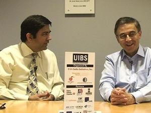 Ani Agnihotri, left, and John McIntyre discuss the outcomes of the second USA-India Business Summit.