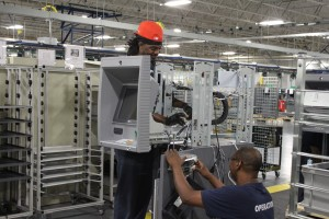workers in ncr factory in columbus put together an atm
