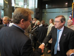 U.K. Consul General Pilmore-Bedford reaches out to France's consul general, Denis Barbet.